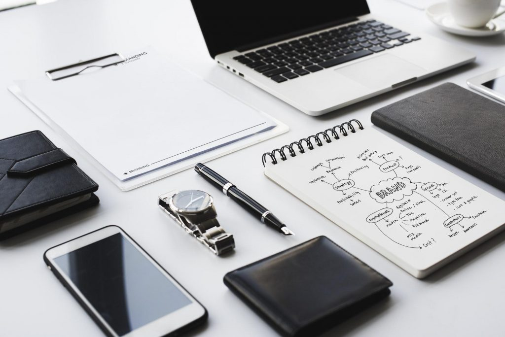 Closeup of black and white stationery on white table